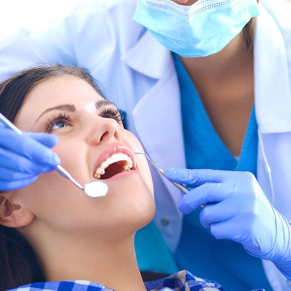 Уход после имплантации зуба